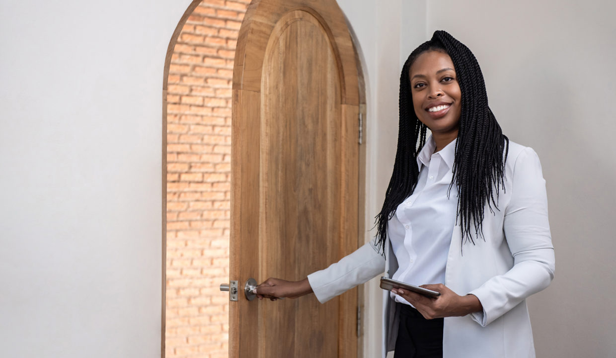 Smiling African American Woman - guide to buy property in gambia